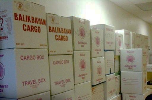 Solons urge quick implementation of Balikbayan box law
