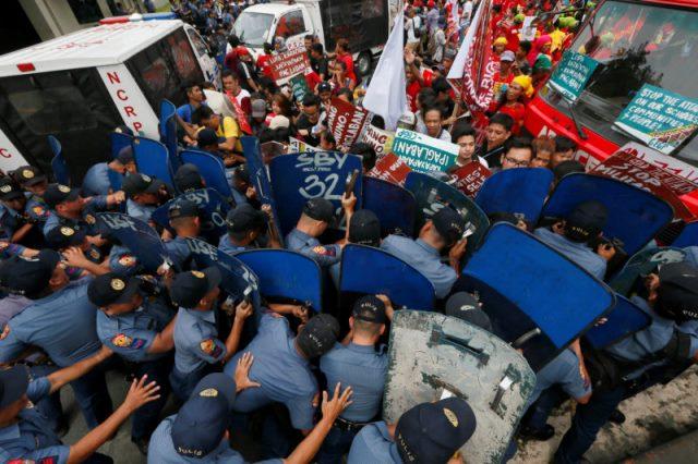 PNP van rams protesters in front of US Embassy in Manila