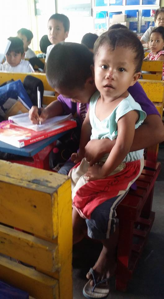 Viral: Boy takes care of brother in classroom