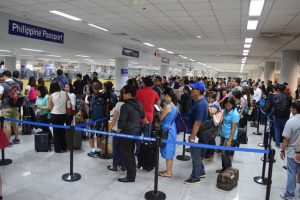 Passengers form long queues to the immigration counters at the Ninoy Aquino International Airport Terminal 3 on Thursday morning. Some passengers missed their flights as the whole check-in process took hours due to the shortage of manpower from the Bureau of Immigration. Photo by Raoul Esperas for ABS-CBNnews.com