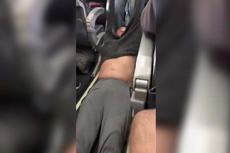 Video of passenger dragged off overbooked flight sparks social media storm