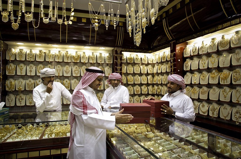 Price of gold edges lower globally
