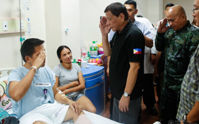 Duterte gives medals to cops wounded in NPA ambush