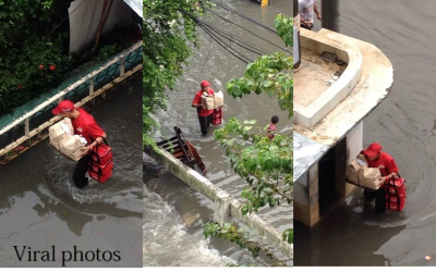 LOOK: Delivery guy braves floods in QC for his job