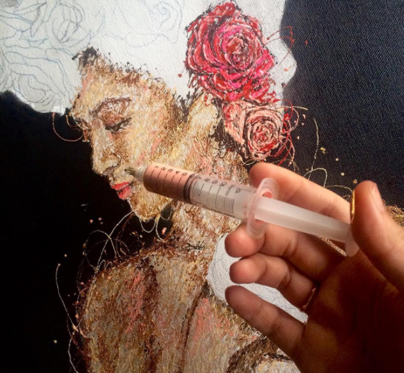 Pinay nurse gets int'l recognition for painting using syringe