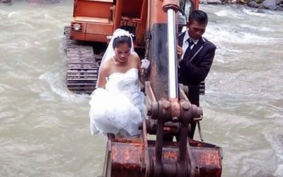 Backhoe to Forever: Bride and groom scooped up to make it to wedding