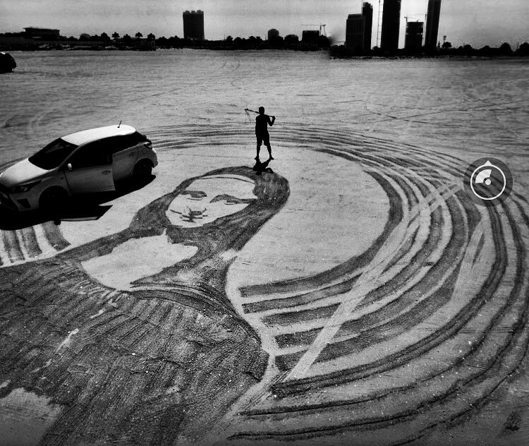 Filipino turns Dubai into a huge canvass for his sand-and-rake art