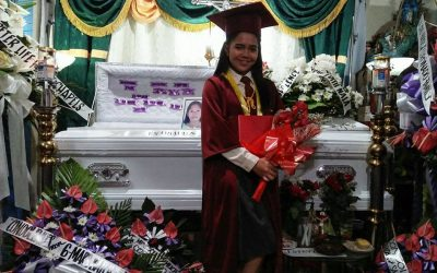 Grad student poses in a photo next to mom's casket, shares emotional message