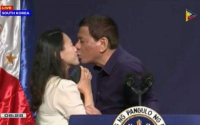 WATCH: President Duterte receives mixed reactions after kissing OFW on stage