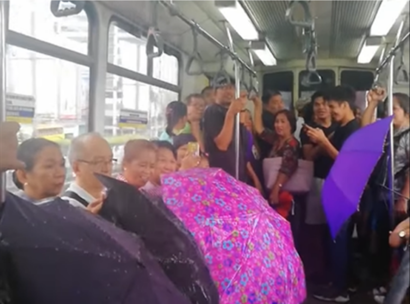 WATCH: Here's why these passengers use umbrellas inside MRT