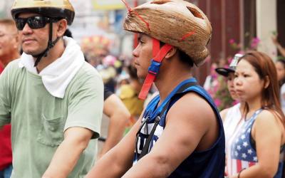 LOOK: Pinoy biker uses coconut husk as helmet