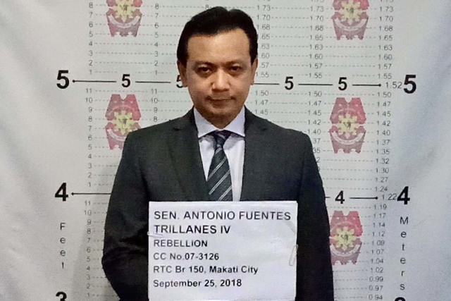 LOOK: Trillanes poses for mugshots; posts Php200,000 bail to secure temporary freedom