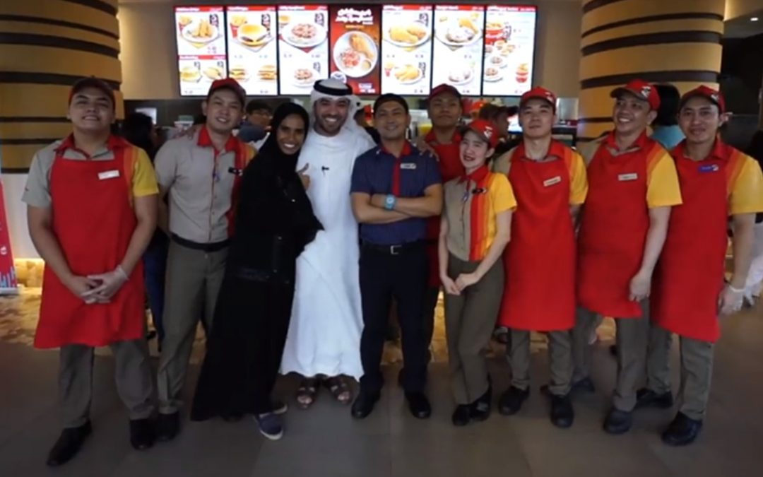 Khalid Al Ameri serves customers at Jollibee in Burjuman