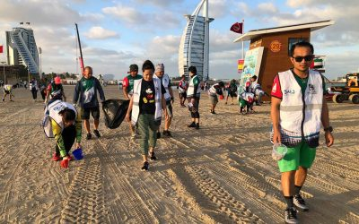 OFW Cyclists, fellow expats lead beach clean up drive
