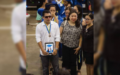 OFW father attends graduation to receive deceased daughter's medal