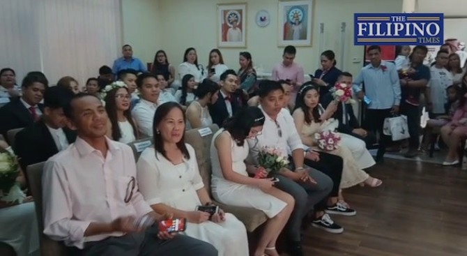 Watch: OFW couples declare their love in mass wedding at consulate