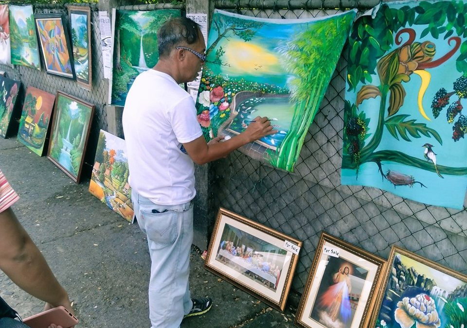 Local artist in Iloilo City raises funds for wife's dialysis through his artworks