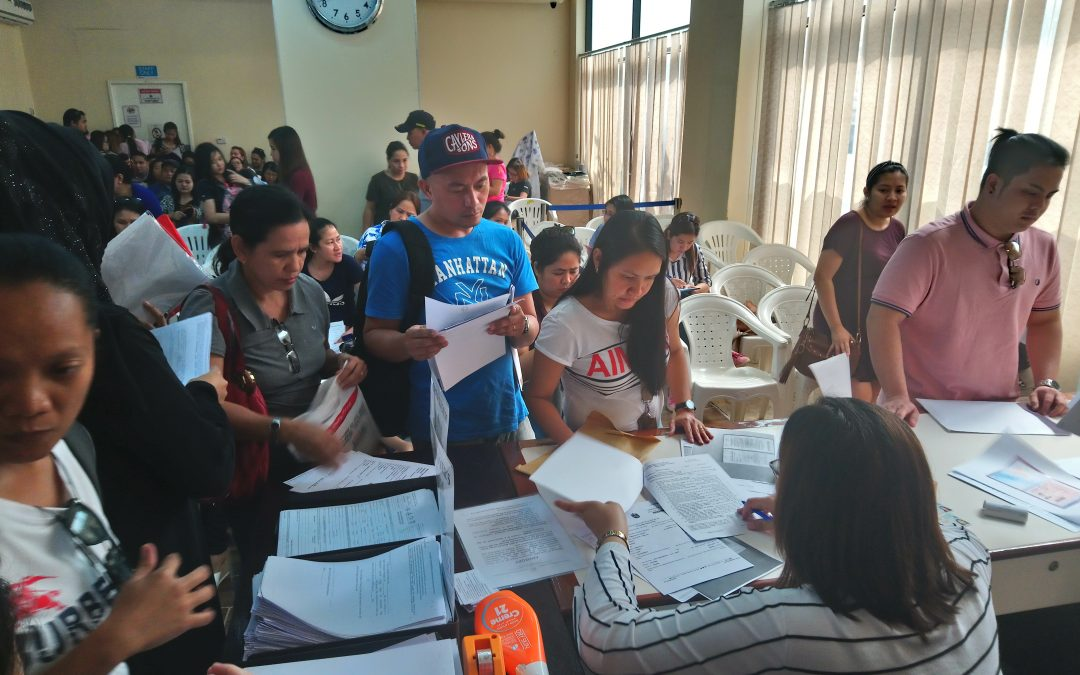 OFWs cram POLO for contract check to obtain OEC