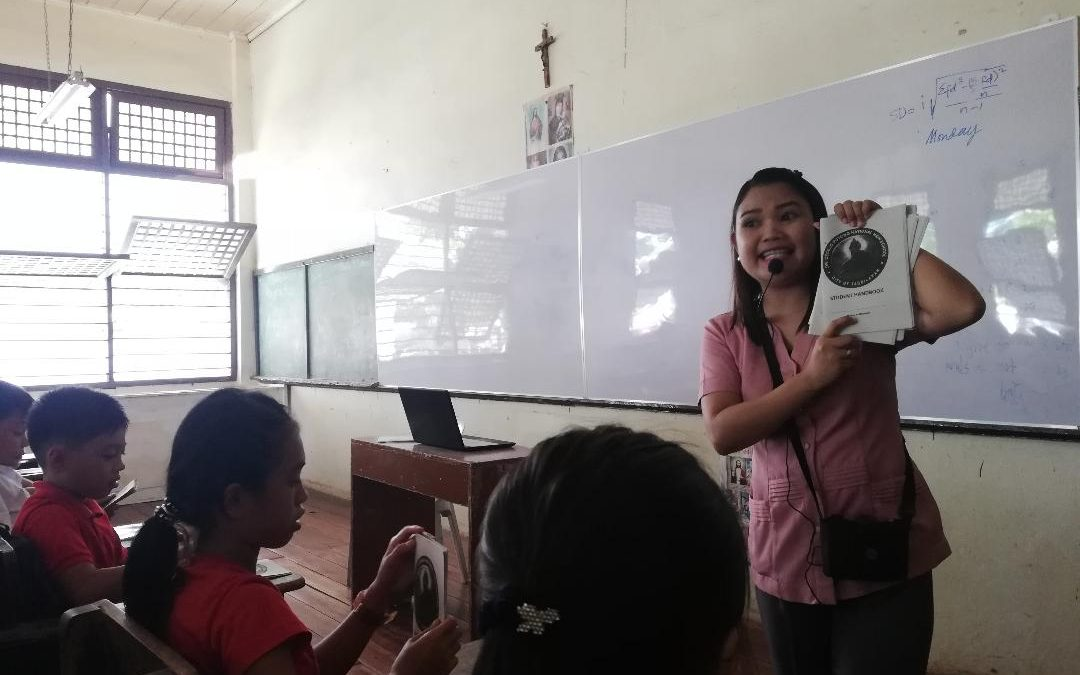 Teachers use lapel mic to beat noise
