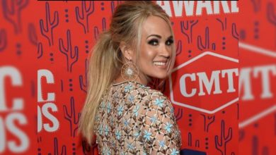 Photo of Carrie Underwood in Michael Cinco dress named Best Dressed at CMT Music Awards