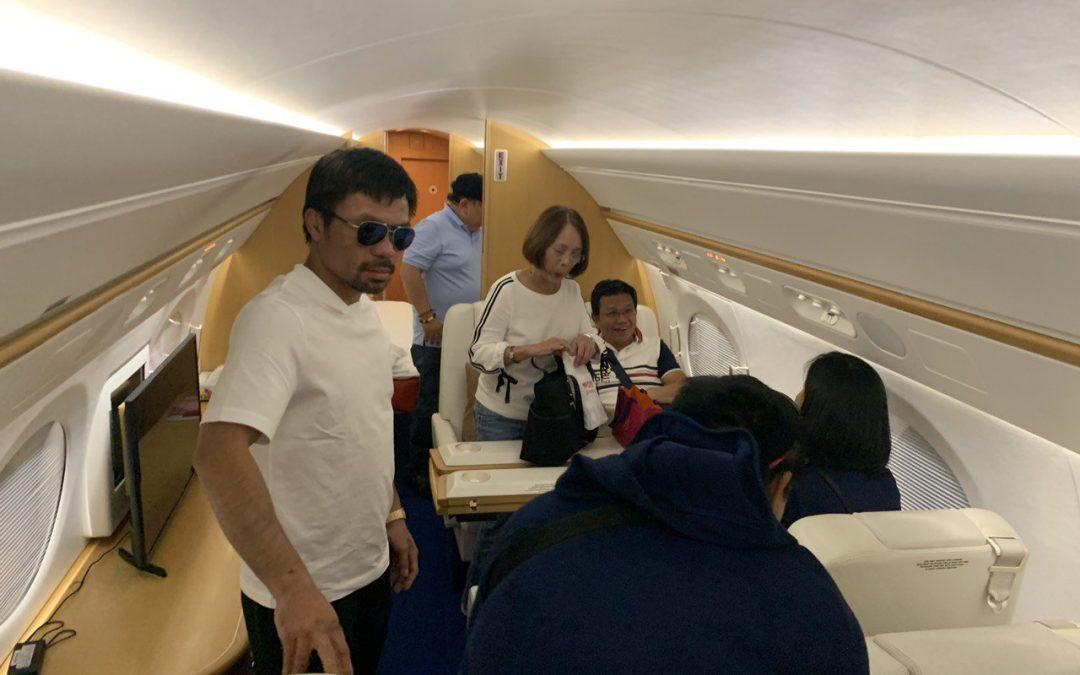 Pacquiao boards private plane back to Manila