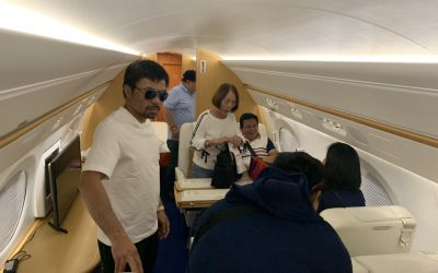Pacquiao boards private plane back to Manila