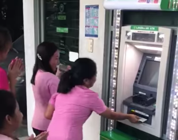 Group of women caroling in front of an ATM goes viral