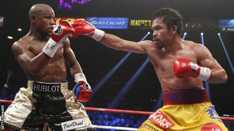 Mayweather says exhibition fight with Pacquiao in the works