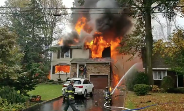 WATCH: Pilot killed as plane crashes into houses