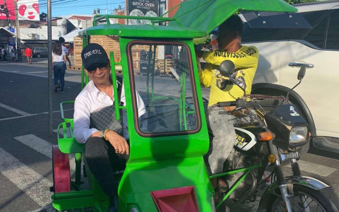 Panelo rides tricycle in Bacolod