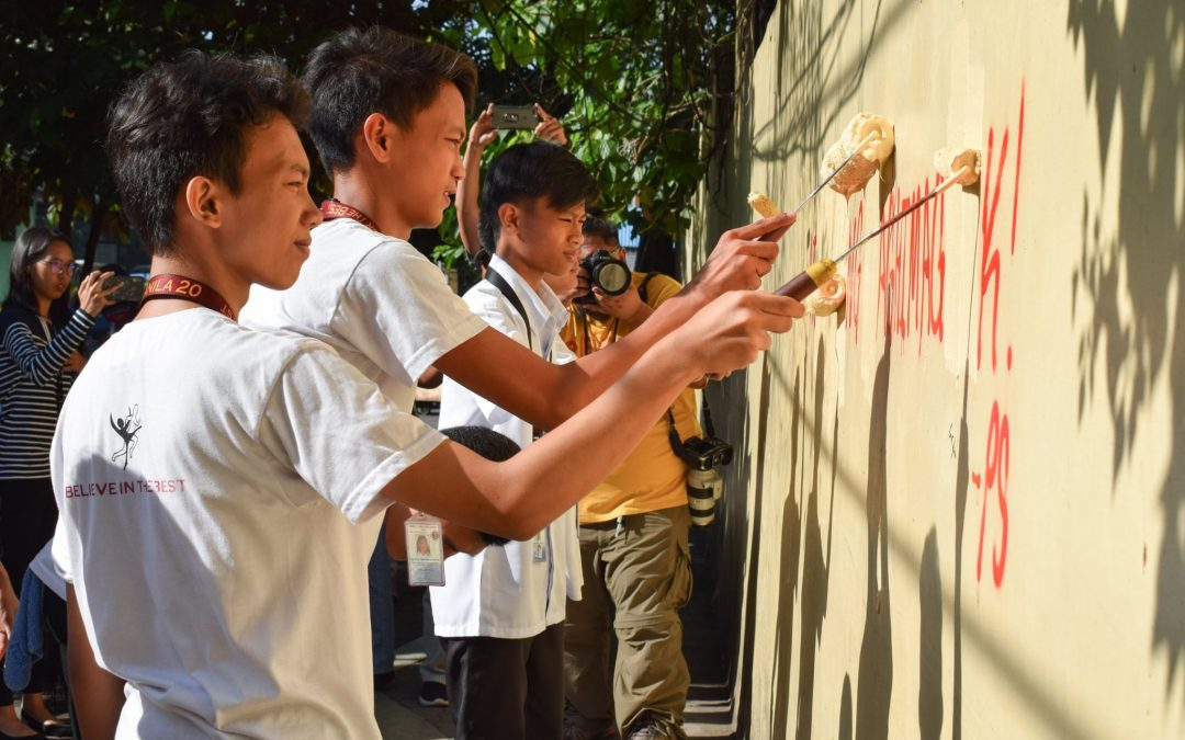 LOOK: Students, teachers volunteer to clean school walls vandalized by militants