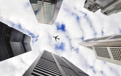 Passenger attempts to open door of plane mid-air