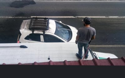 LOOK: Good Samaritans wash away ash from cars leaving Taal volcano area