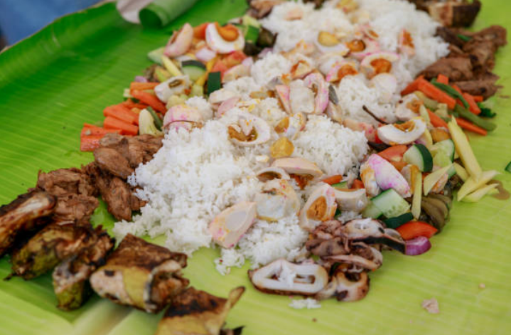 Why do Filipinos love eating with their hands?