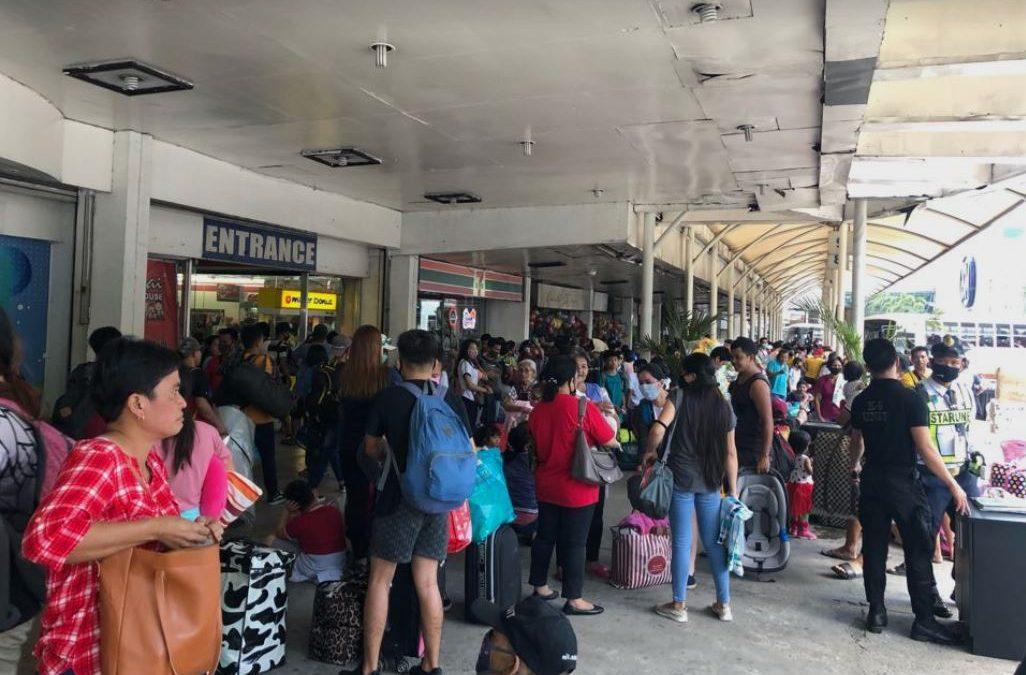 Passengers flock bus terminals ahead of Metro Manila's 'community quarantine'