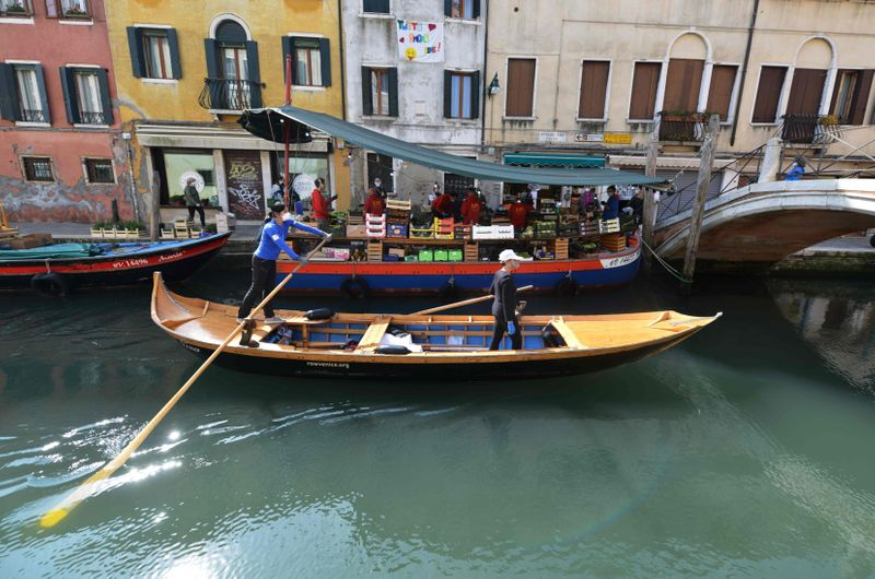 IN PHOTOS: NGO delivers food for Venice's elderly, people vulnerable to COVID-19 via gondolas