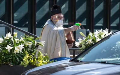 LOOK: Priest uses water gun to dispense holy water for faithful