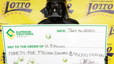 Photo of Shy lotto grand prize winner in Jamaica collects winnings in Darth Vader costume
