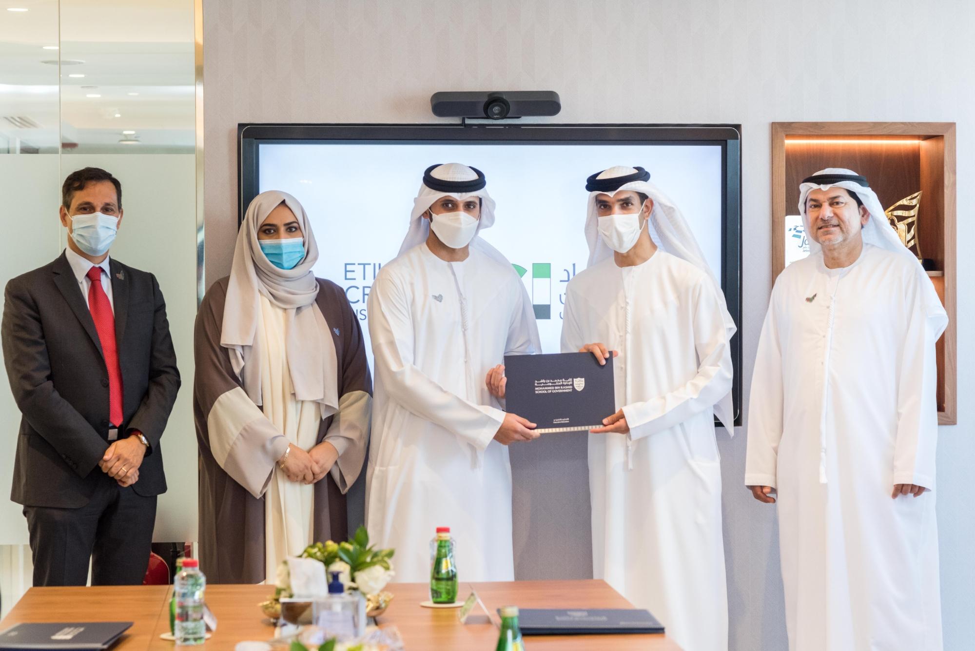 "H.E. Dr. Thani bin Ahmed Al Zeyoudi handing one of ECI employees ""LEAD Program"" certificate"